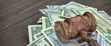 Stack Of Banknotes With Judges Or Auctioneers Gavel Or Hammer. Stack Of Dollar Banknotes With Judges Or Auctioneers Gavel Or Hammer, Trial Or Tribunal Concept stock photography