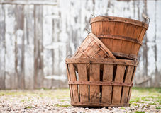 Stack of baskets. Three empty apple orchard baskets stacked in front of the barn Stock Image