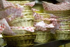 Stack of baskets with checkered paper Stock Photo