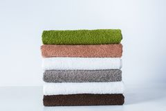 Stack bath towels colorful textile background Stock Photo