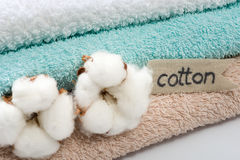Stack of bath towels with cotton blossom Stock Photography