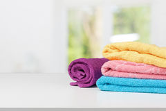 Stack of bath towels. On light white background closeup Stock Images