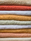 Stack of bath towels in orange and beige colors Royalty Free Stock Image