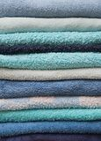 Stack of bath towels in shades of blue Stock Images