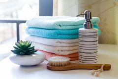 Stack of bath towels. With toothbrushes on table Royalty Free Stock Image
