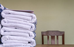 Stack of bath towels on wooden table Royalty Free Stock Photography