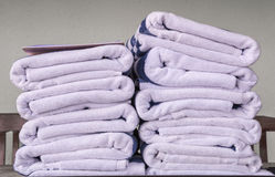 Stack of bath towels on wooden table Royalty Free Stock Images