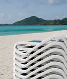Stack of beach chairs at Church Valley beach Stock Images