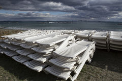 A stack of beach lounges out of season. Stock Image