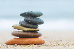 Stack of beach stones on sand Royalty Free Stock Photo