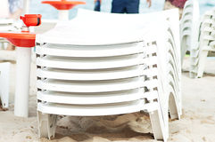 Stack of beach sunbeds. Stock Photos