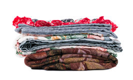 Stack of beautiful handmade quilts. Isolated on the white backgroud Royalty Free Stock Image