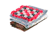 Stack of beautiful handmade quilts. Stock Photos