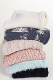 Stack of beautiful handmade sweaters with different patterns. Royalty Free Stock Photos