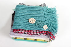Stack of beautiful knitted winter scarves. Stock Photos
