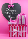 Stack of beautiful pink presents with Happy Mothers Day message Royalty Free Stock Images