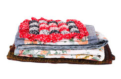 Stack of bedding set with flowers. Royalty Free Stock Photo