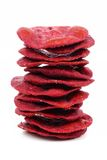 Stack of beet crisps isolated on white. Stack of beet crisps isolated on a white background Stock Photography