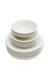 Stack beige dinner plates, soup plates and saucers Royalty Free Stock Photography