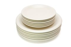 Stack of beige plates and saucers Stock Image