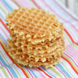 Stack Belgian waffles on a colored tablecloths Stock Images