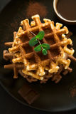 Stack Belgian waffles iced cocoa with chocolate sauce decorated mint leaves o Royalty Free Stock Photo
