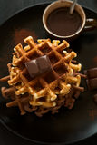 Stack Belgian waffles iced cocoa with chocolate sauce decorated mint leaves o Stock Image