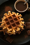 Stack Belgian waffles iced cocoa with chocolate sauce decorated mint leaves o Royalty Free Stock Photos