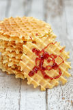 Stack of Belgian waffles with jam on a  wooden background Royalty Free Stock Image