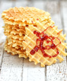 Stack of Belgian waffles with jam on a  wooden background Stock Image