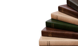 Stack of Bibles. Bibles stacked one on each other isolated stock photography
