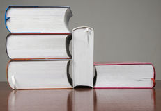 Stack of big books. On desk stock photo