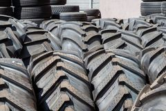 Stack of big car tires outside. Outside of a tire shop royalty free stock image