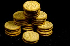A stack of big round sweet cookie`s. A cookie is a baked or cooked food that is small, flat and sweet. It usually contains flour, sugar and some type of oil or Stock Photo