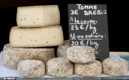 Stack of Biger France Cheese. Sale im the market Stock Image