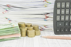 Stack bill and gold coins near brown pencil and calculator Stock Photography