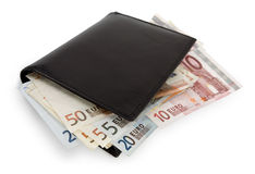 Stack of bill in wallet. Stack of euro banknotes in black wallet isolated on white. Clipping path incl Royalty Free Stock Image