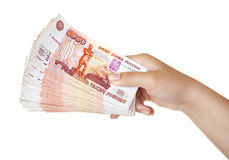 Stack of bills in the female hand. Stack of five thousandth bills in the female hand Royalty Free Stock Images