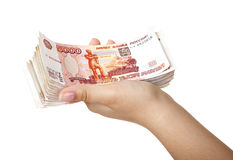 Stack of bills in the female hand. Stack of five thousandth bills in the female hand Royalty Free Stock Photography