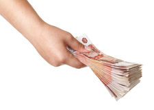 Stack of bills in the female hand. Stack of five thousandth bills in the female hand Stock Image