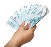 Stack of bills in the female hand. Stack of one thousandth bills in the female hand Royalty Free Stock Images