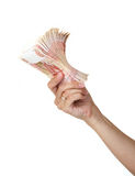 Stack of bills in the female hand. Stack of five thousandth bills in the female hand Royalty Free Stock Image