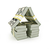 Stack of bills in the shape of a house Stock Photos