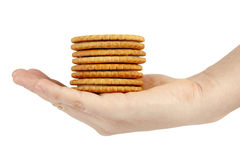 Stack of biscuits in woman hand isolated on white background Stock Photos