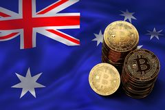Stack of Bitcoin coins on Australian flag. Situation of Bitcoin and other cryptocurrencies in Australia. Concept. 3D Rendering Stock Image