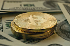 Stack of Bitcoin coins on dollar cash money background Stock Photo