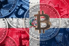 Stack of Bitcoin Dominican Republic flag. Bitcoin cryptocurrenci. Es concept. BTC background royalty free stock photography