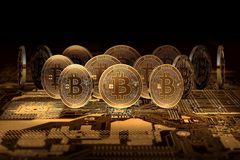 Stack of Bitcoins standing on motherboard. Bitcoin domination concept Stock Photo