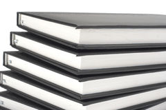 Stack of black books. Over white Royalty Free Stock Photography