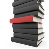 Stack of black books with standing out red one. Royalty Free Stock Images